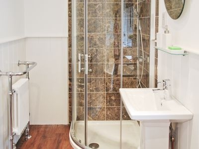 Power walk in shower with basin, WC and radiator
