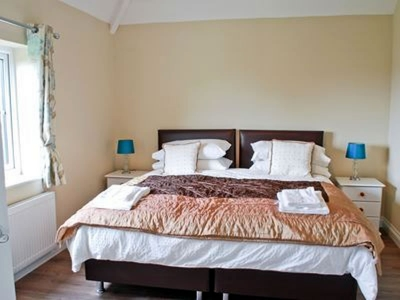 Double Bedroom with Sea Views, Wardrobe and chest of drawers.